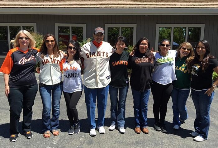Dental team wearing Giants clothes